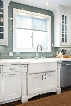 Grey glass subway tile kitchen backsplash with  farmhouse sink but change the also butcher block from white cabinets