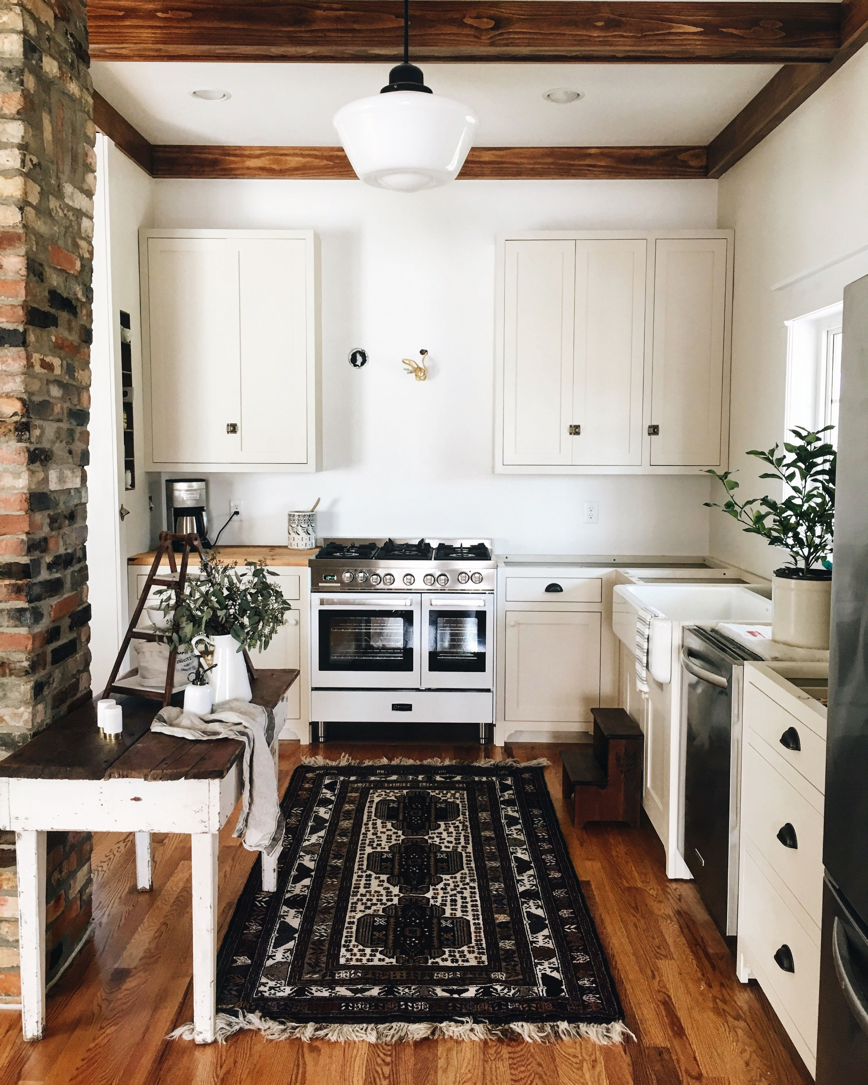black and white kitchen rug stainless steel knobs for cabinets warm with wood flooring beams vintage in