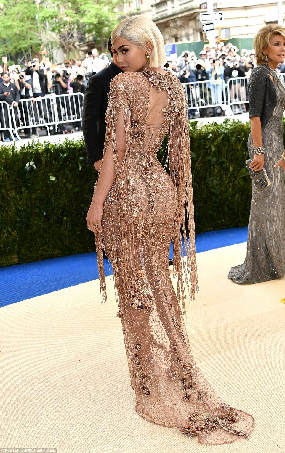 Sheer style  The reality star s outfit was backless and had long tassels  that fell from the shoulders e302e09df3c