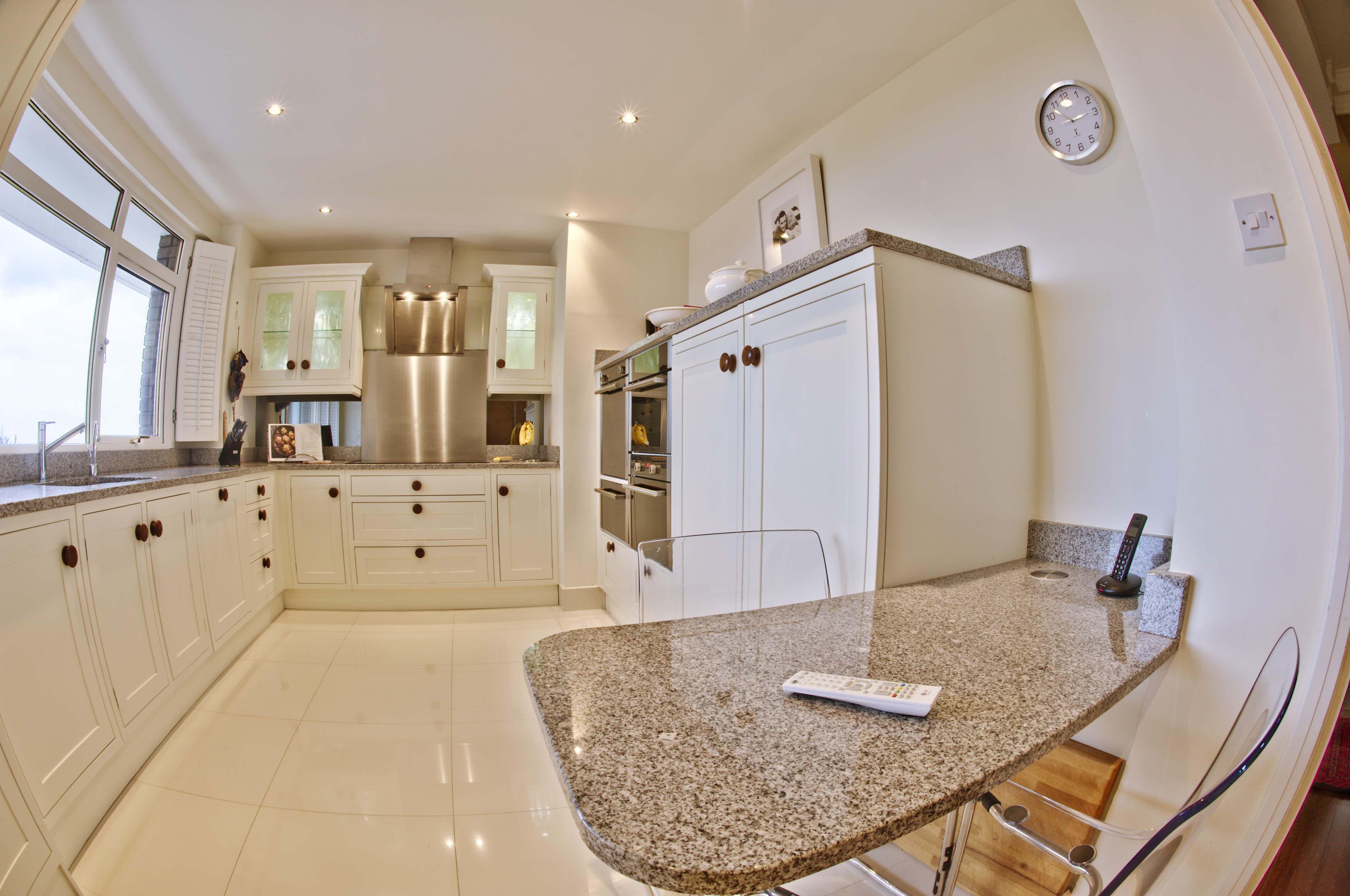 Modern cream kitchen with walnut door knobs by George Bond Interior ...