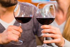 Young handsome couple drinking red wine