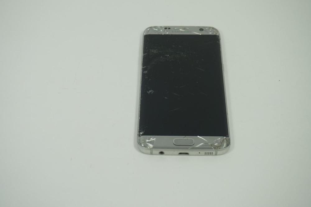 1b76bb813a4 BROKEN AS-IS Silver Samsung Galaxy S7 Edge 32GB SM-G935T T-Mobile ...