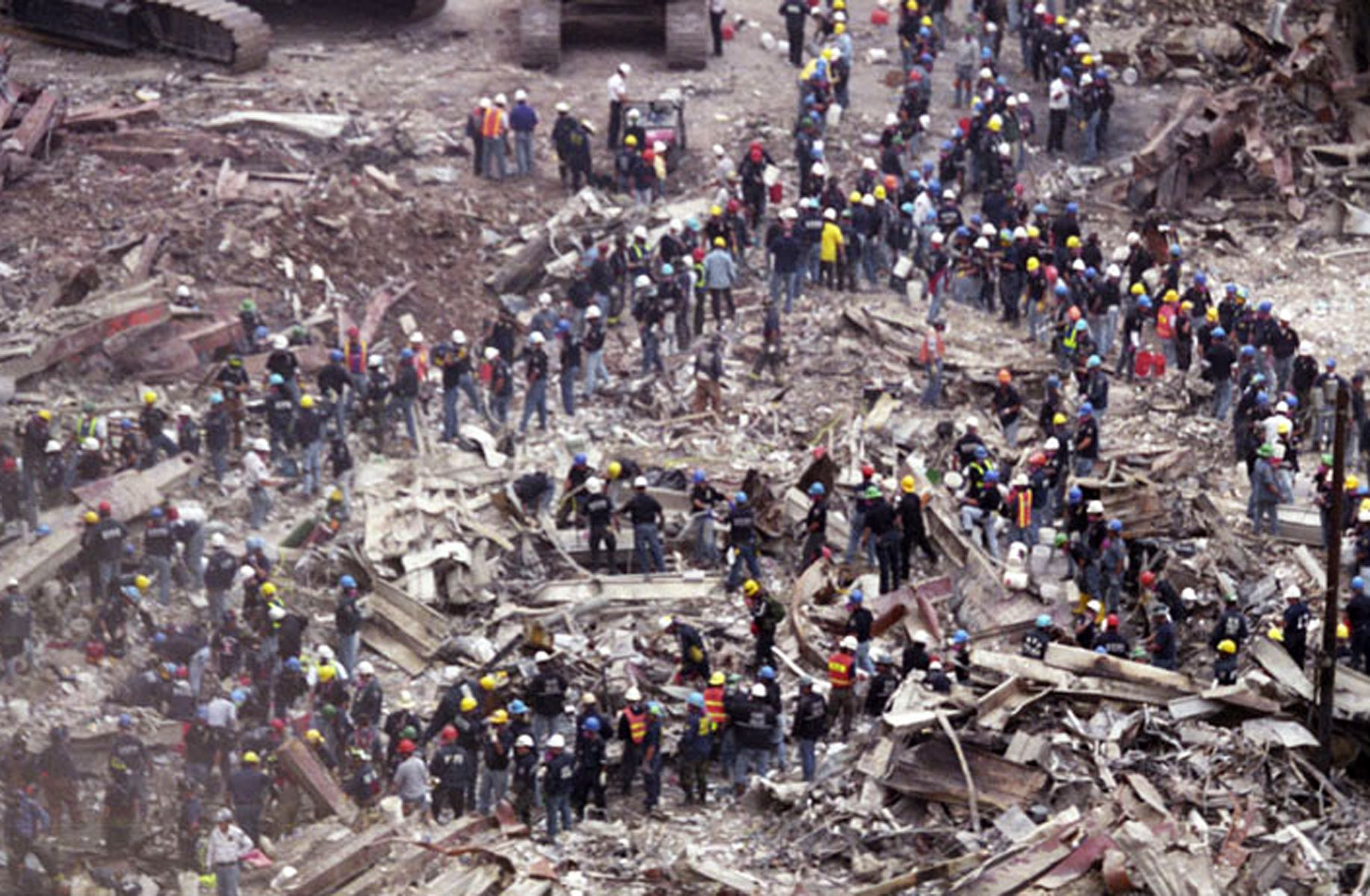 """The day after the horrific events of September 11, thousands of construction workers, first responders, and self-dispatched volunteers converge at Ground Zero to search for survivors, improvising """"bucket brigades"""" to remove debris from the mountainous pile formed by the collapse of the World Trade Center."""