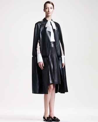 Leather Cape [$7980], Tie-Neck Silk Blouse [$1100] & Leather A-Line Skirt [$2390] by Valentino at Bergdorf Goodman.