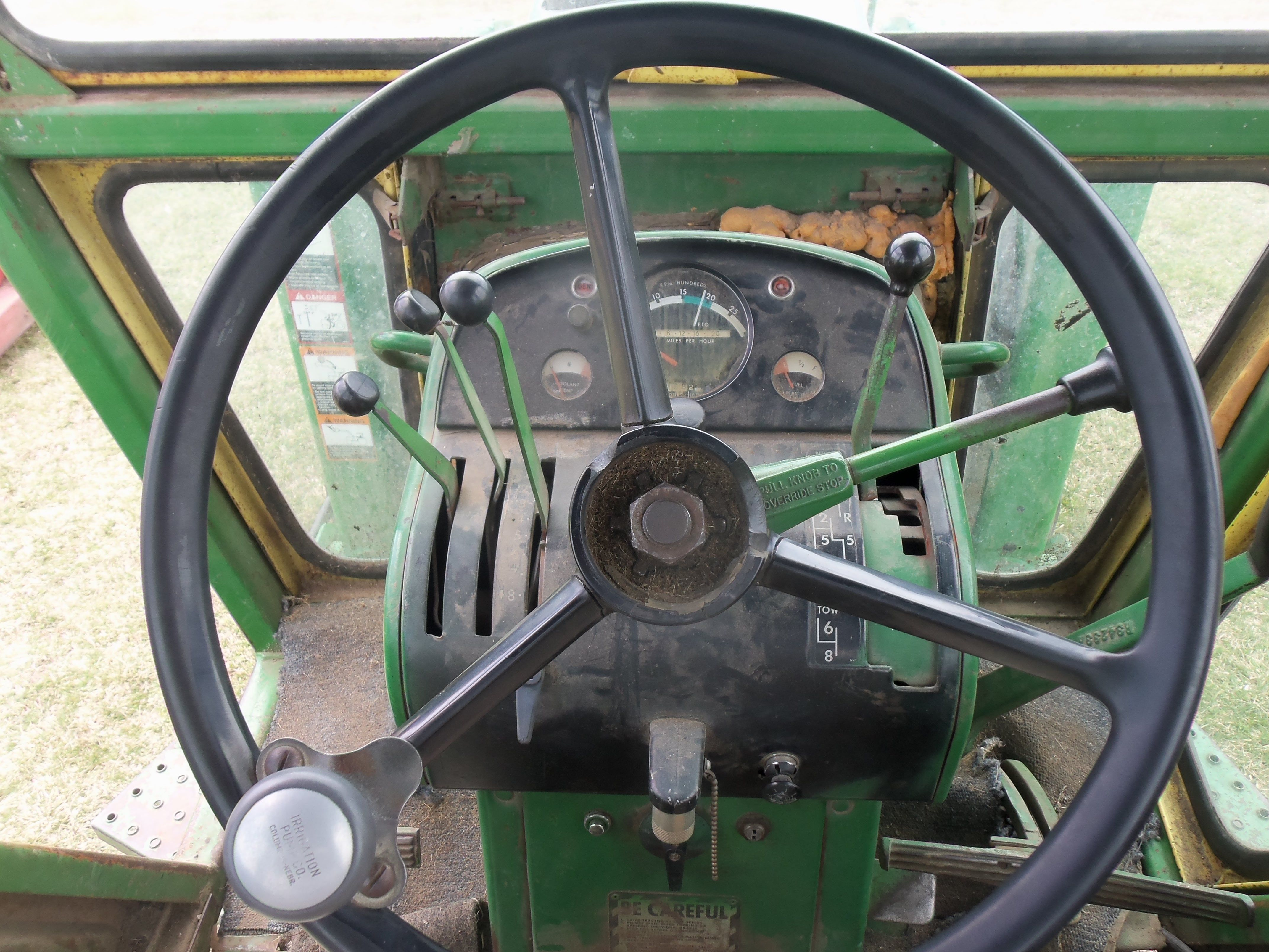 The John Deere steering wheel & controls On right the 8 speed Syncro