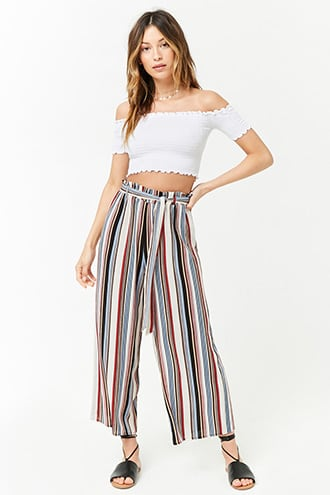 1453b458ea8a ... of cropped woven pants featuring an allover striped pattern, a  high-rise, an elasticized paperbag waist with a removable self-tie sash,  and a wide- leg.