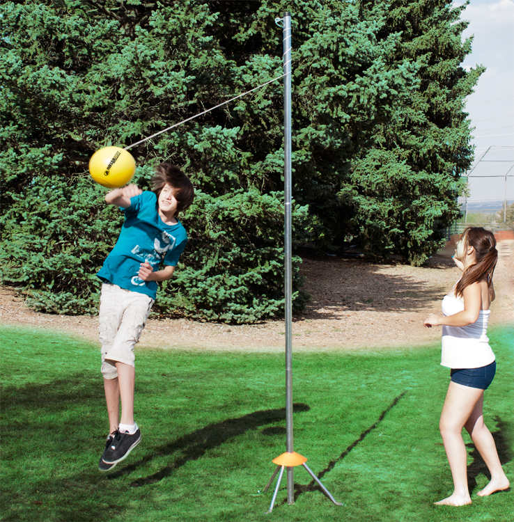 The Equipment Consists Of A Stationary Metal Pole From Which Is Hung A Volleyball From A Rope Or Tether