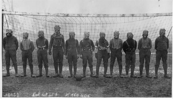 Football team of British soldiers with gas masks, World War I, somewhere in Northern...