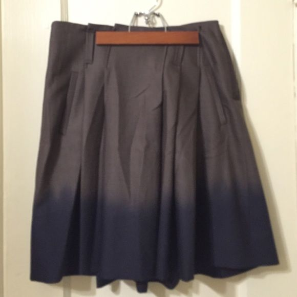 Classy skirt, made in Italy, very unique design. Brown and blue skirt, 100% virgin wool, size 6,  no belt, pockets on both sides, 3 belt inserts, side zip-up. Gunex Skirts Midi