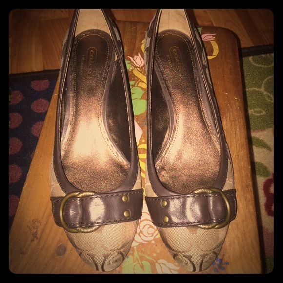 Coach wedge shoes Reposed. I was told they were a 10 and they are clearly not. They fit a 9 to 9.5. I'm a 10 and they totally don't fit. Just as easy to reposed. Brown coach c logo. In great condition. Bottoms have hardly any wear. I wore in the house only to see if they were able to be stretched. They are not so I pass them on to a new owner. Coach Shoes