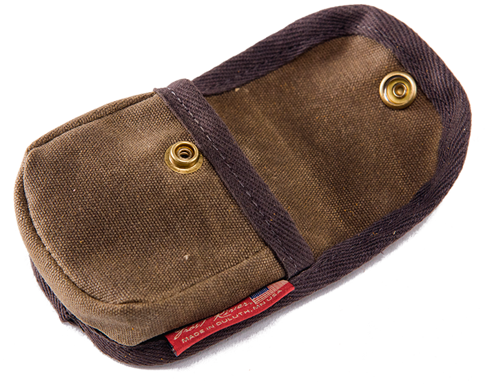 A small pouch built tough from our heavy-duty waxed canvas with a solid  brass snap and a leather belt loop. d9ad673c38cf