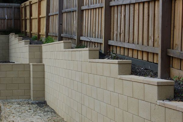 Retaining Wall Along Fence Line Block Walls Fence Idea Retaining Wall Fence Design Fence