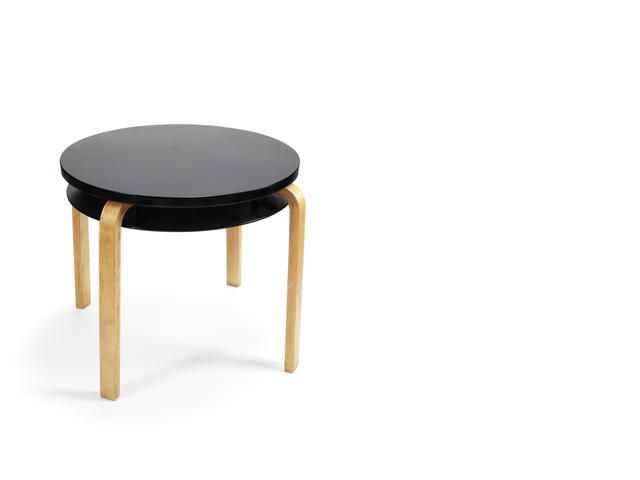 Alvar Aalto for Finmar Ltd Table 70 designed 1933 applied plaque for Finmar Ltd birch faced moulded plywood with lacquered tops. Height: 56.5 cm. 22 1/4 in. Diameter: 62.5 cm. 24 5/8 in.