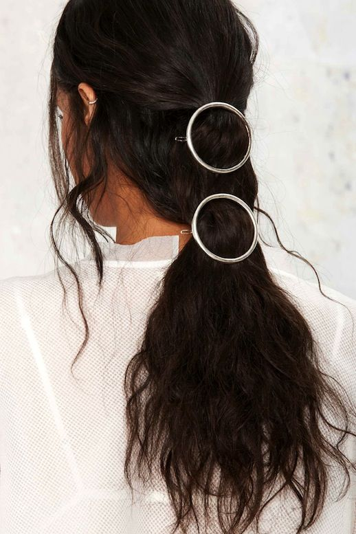 We are always searching for easy ways to bring our hairstyles to the next level. One of the easiest ways to do this is with the help of cool hair accessories like a circle hair clip, or in this case two. All you have to do is pull back the top half of your hair with one and secure the rest further down with the other for an instantly elevated look. Check out even more ways to wear a circle clip.