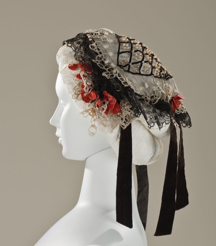LACMA Collections Online; English woman's bonnet (fanchon), c. 1860; linen net with lace, silk-velt ribbon, faux pearl glass beads; overall: 14-3/4 x 11-1/2 x 8 inches