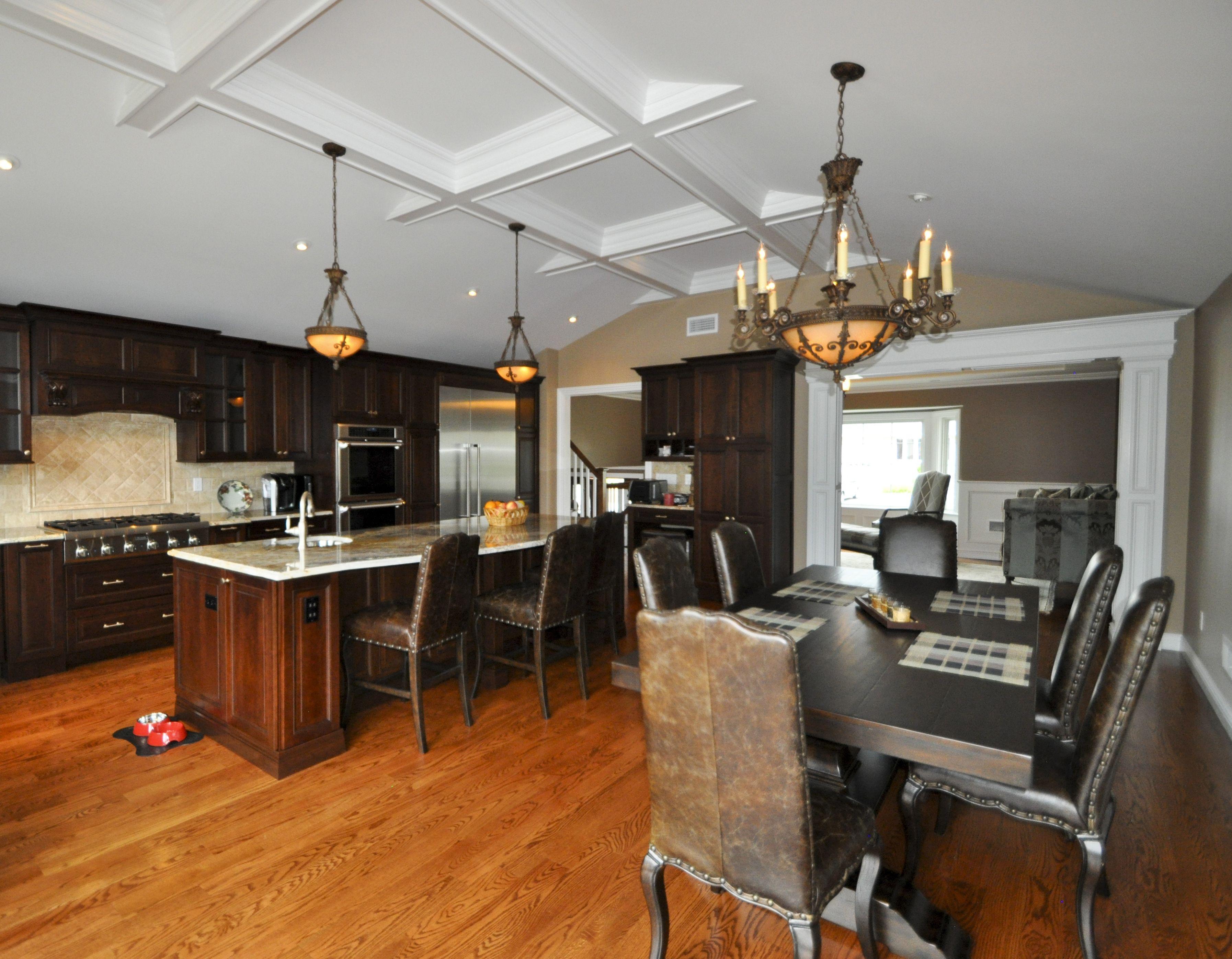 custom kitchen with open floor plan to dining room