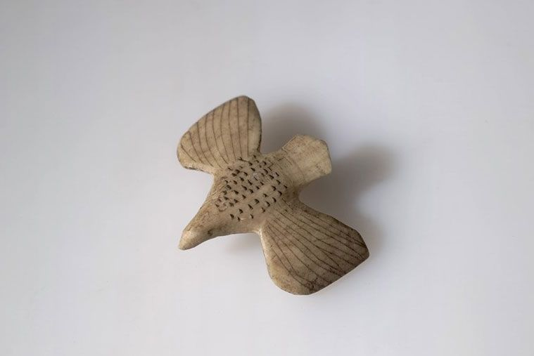 Carving, flying bird. Koryak, Siberia, North Kamchatka (1901, Jesup expedition). Ivory, sinew © American Museum of Natural History