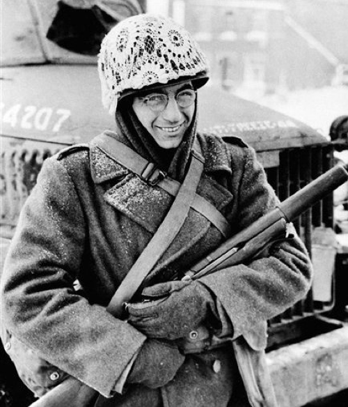 """""""Sgt William Furia of Philadelphia, PA, wears a piece of a fancy lace curtain for a helmet cover. Starting as a joke, the lace decoration has proven practical as snow-camouflage cover in Luxembourg"""" - The Windsor Daily Star - Feb 9, 1945"""