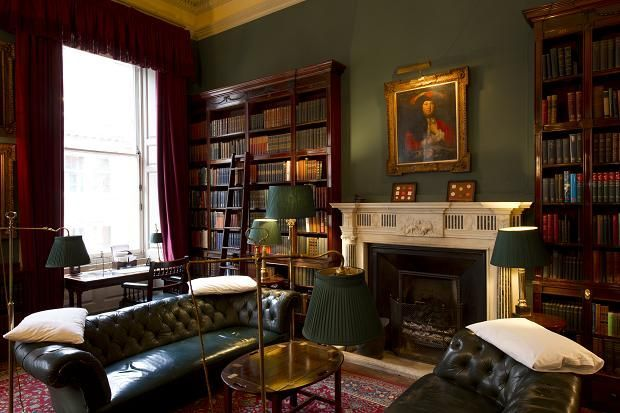 English Club style ~ tufted leather, books, brass, marble, oriental rugs, portraits…