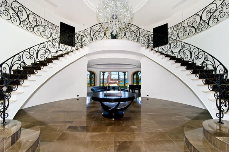 Luxury staircases double curved stairway in new for Double curved staircase