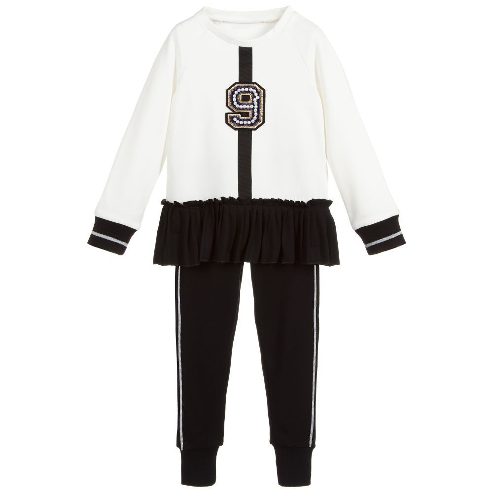 8f29a42bda45 Girls Black   Ivory Tracksuit for Girl by Lapin House. Discover more  beautiful designer Tracksuits for kids online