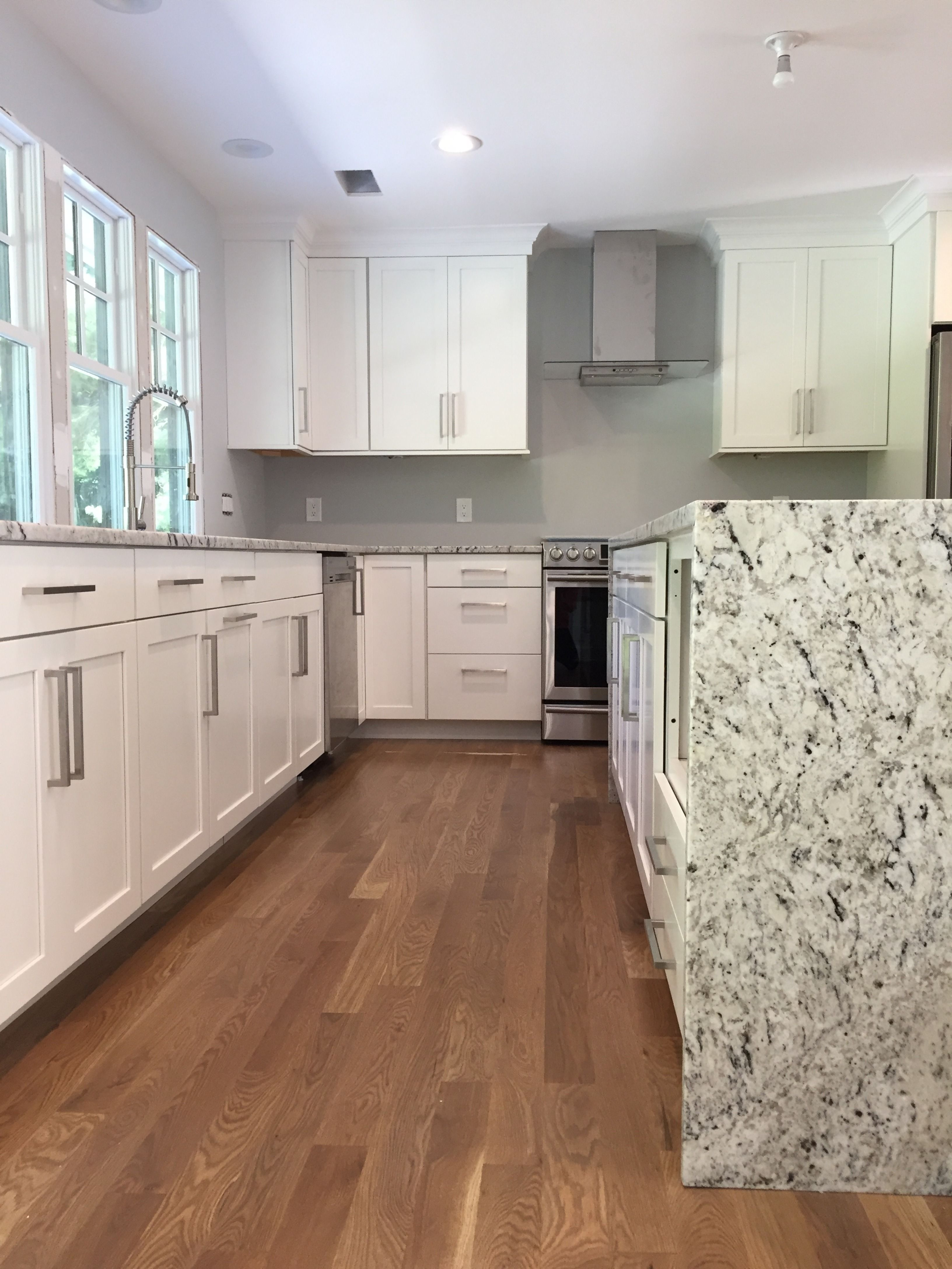 Kitchen Countertops And Waterfall Island Both Done With White Ice
