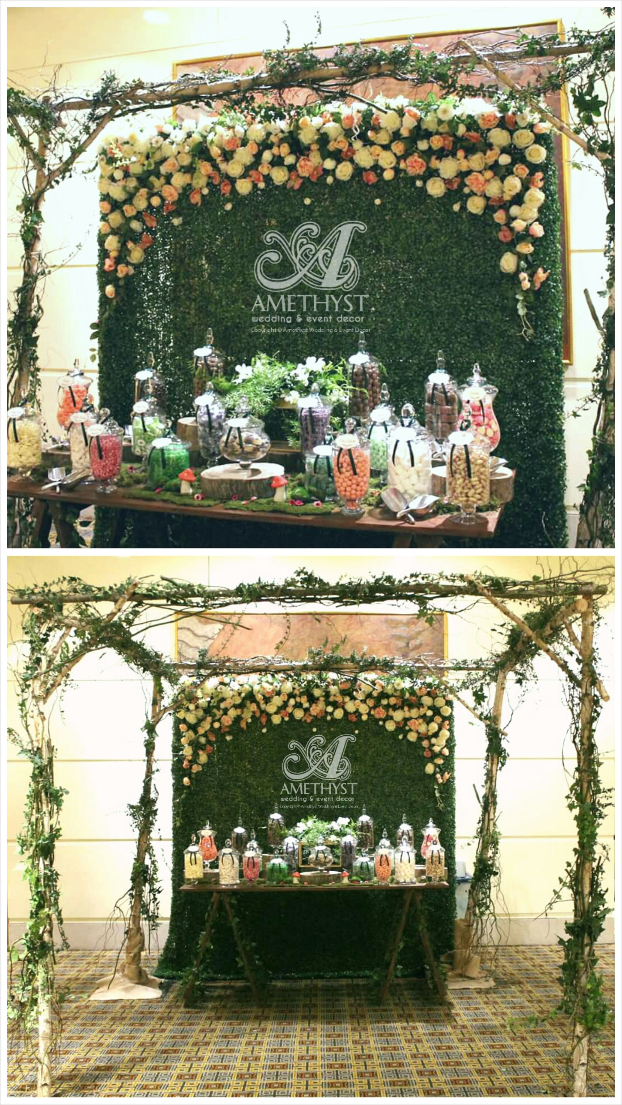candy bar table styling flower wall backdrop boxwood faux grass