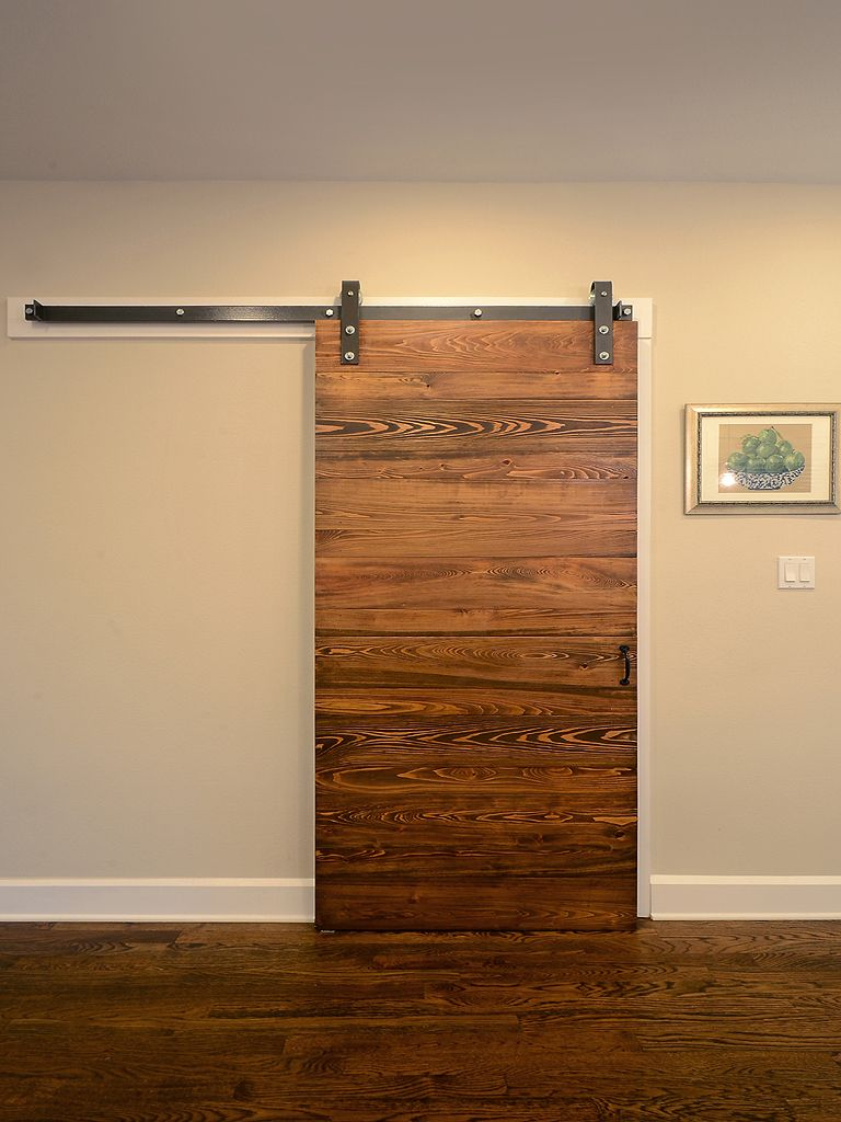 Wood sliding door in front of laundry room