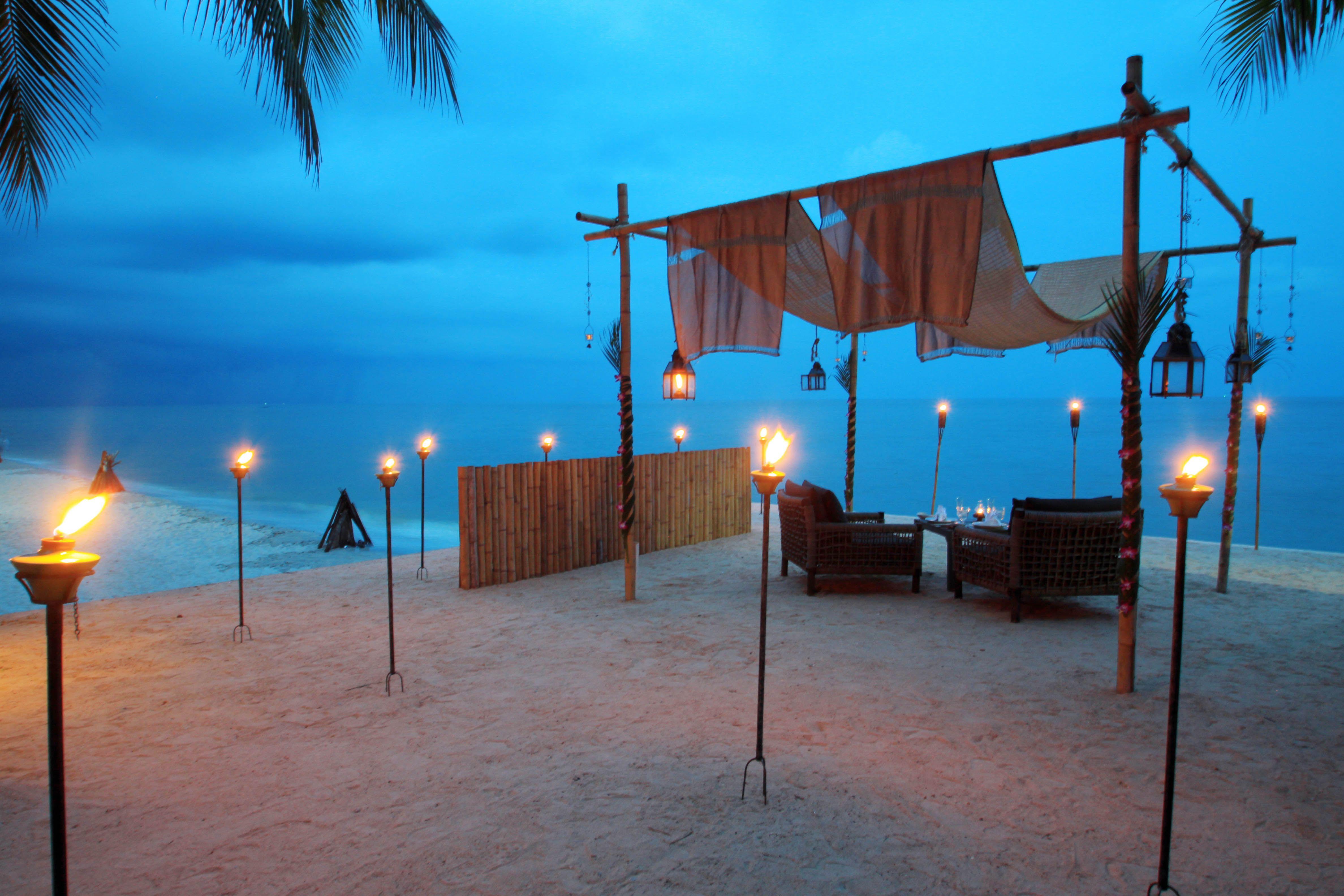 Romantic Candle Lit Beach Dinner Set Up At Anantara Hua