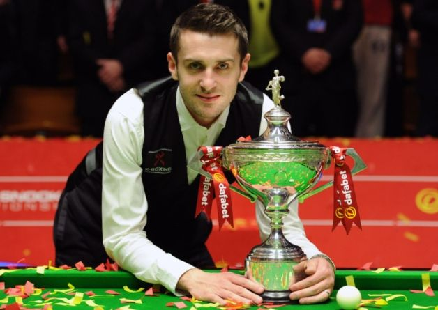 Mark Selby celebrates after winning the final of the Dafabet World ...