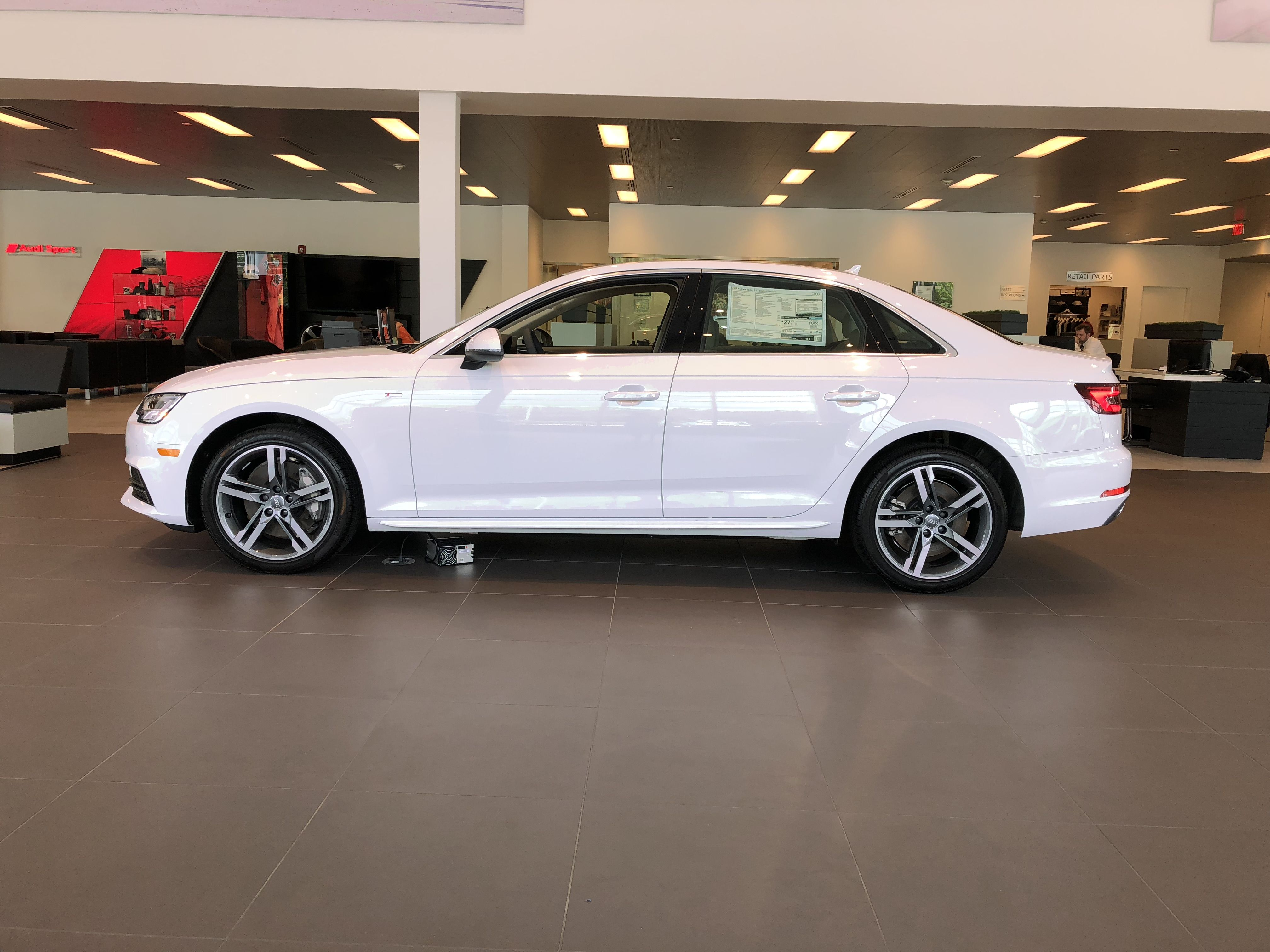 Full side view view of Ibis White Audi A4 located at Audi of