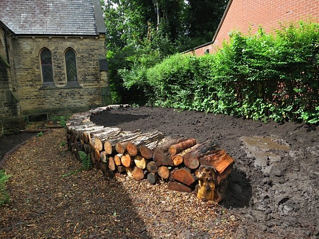 Raised Bed With Log Wall Nearly Ready For Planting With Wildlife Friendly Plants And Shrubs