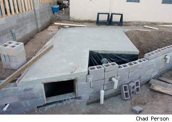 Artist Builds Backyard Survival Shelter, Homemade Shotgun Robot - Asylum.com