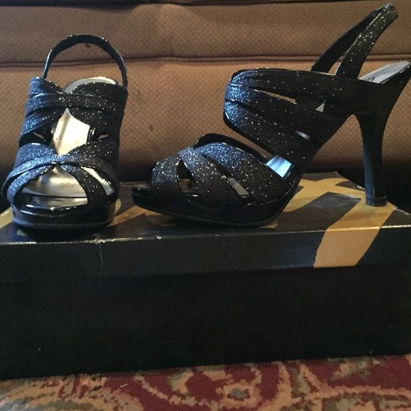Sparkly black heels This super cute sparkly black heels are a size 8. They have a 3 & 1/2 inch heel on them. They are super cute and stylish! They have been worn only once and are in perfect condition! Open to offers!! FIONI Clothing Shoes Heels