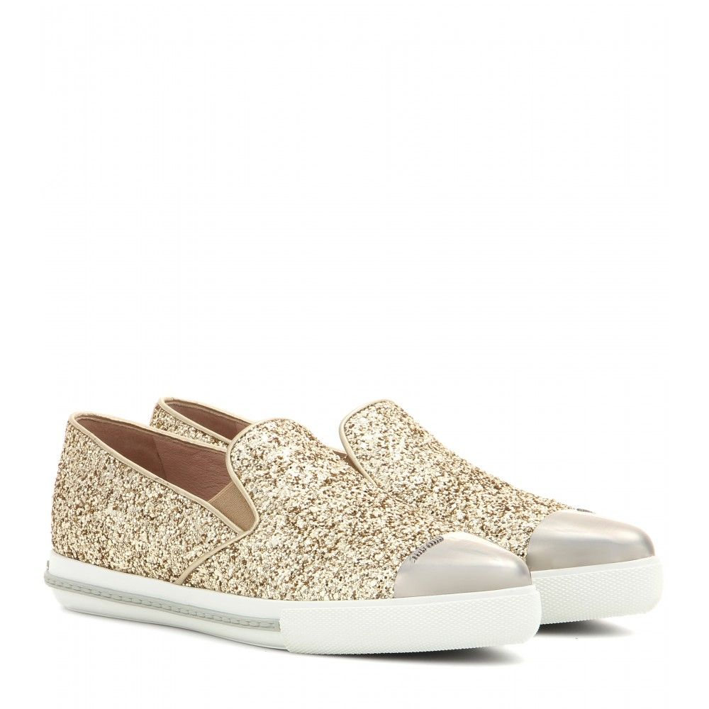 Miu Miu - Glitter slip-on sneakers - Go girly in these glitzy slip-on sneakers. Swathed in golden glitter, they boast an unmistakable touch of Miu Miu magic. We love the pointed metallic toecap and understated silhouette, which serves as the perfect foil to the heavily embellished surface. seen @ www.mytheresa.com