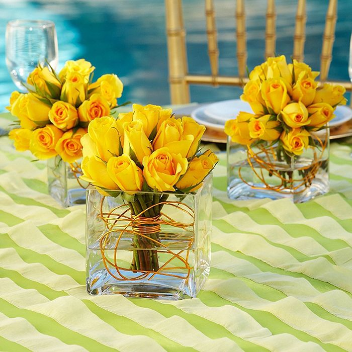 Yellow rose centerpieces with wire centerpiece