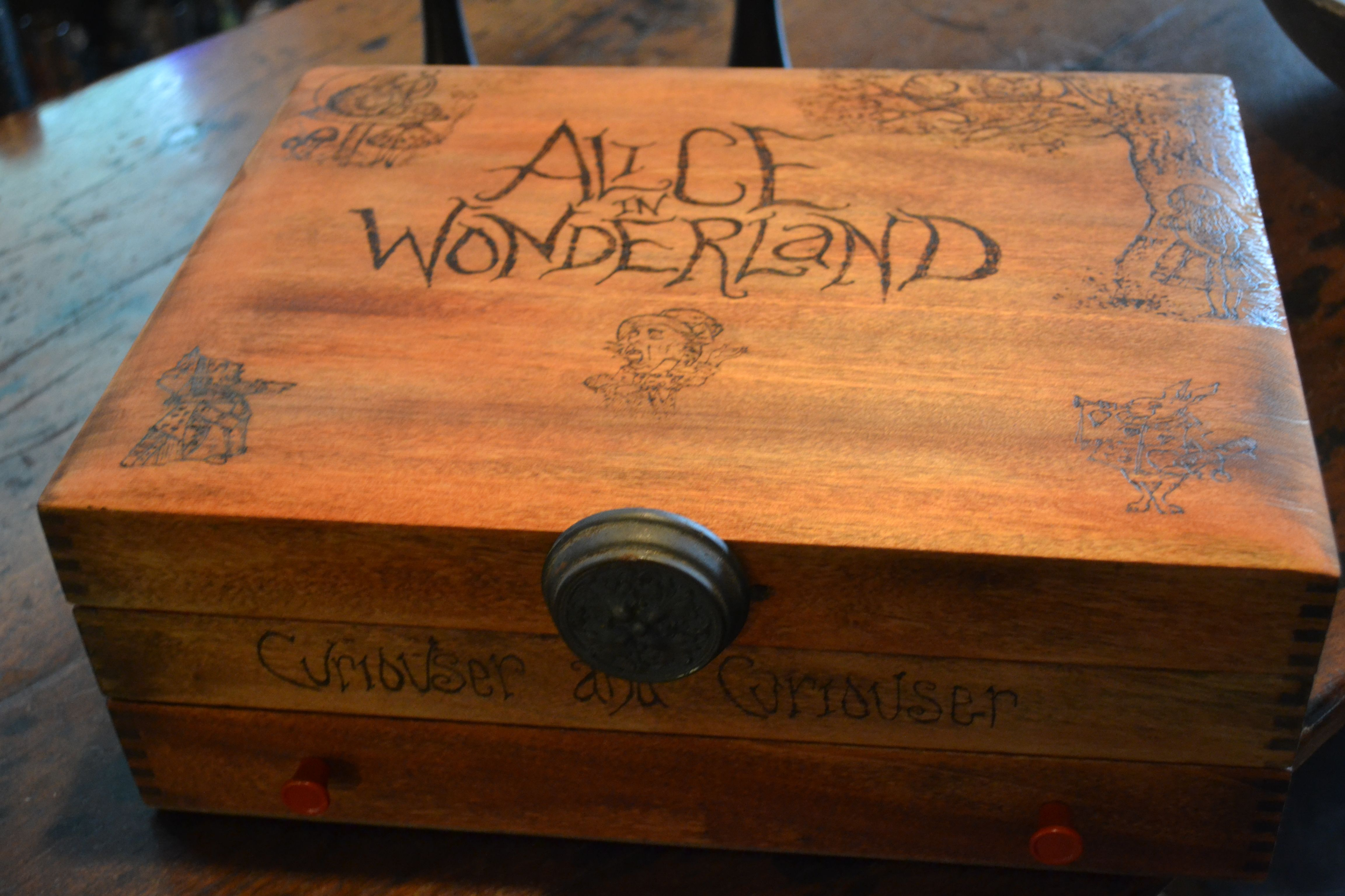 Up cycled silverware chest to my new cash box for festivals. Alice in Wonderland wood burned to last forever! I have my tray, I have my box, now I need to make a chair!