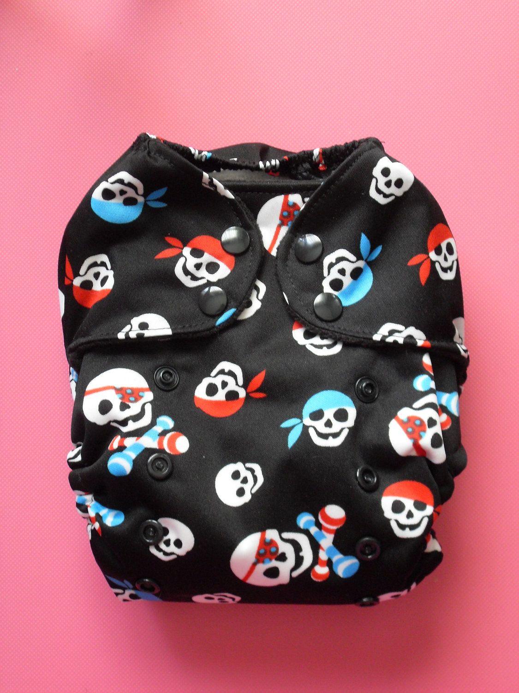 Cute diaper cover! Ahoy Matey - one-size Pirate cloth pocket diaper. $18.00, via Etsy.