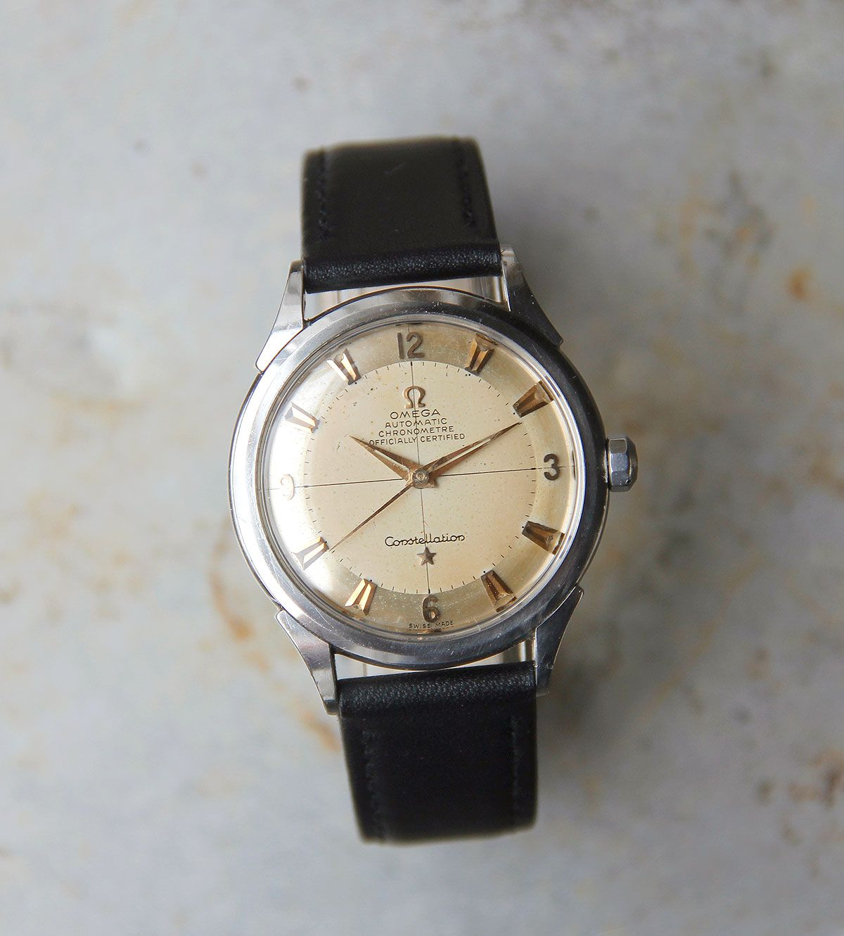 All-original 1954 Omega Constellation bumper. Its original features include: Original two tone dial; ref. 2782 automatic movement yielding 19,800 bph (5.5 beats per second), 17-jewel caliber 354; Incabloc shock protection; sweep seconds; 35mm case featuring engraved Constellation logo on back; signed crown. We have replaced the strap with a new one, and the movement has been fully serviced and regulated. A little history: Constellations of the 1950s through to the … Read More →