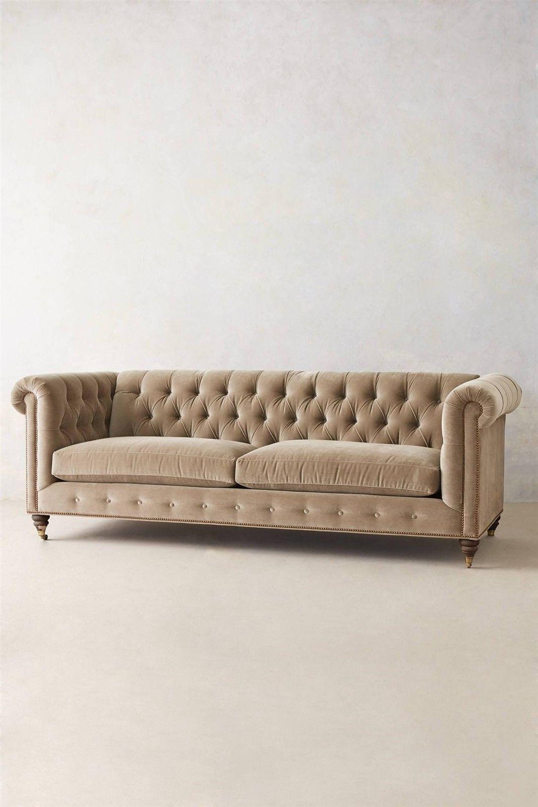 An Oversize Chesterfield Sofa Upholstered In Beige Colored Velvet