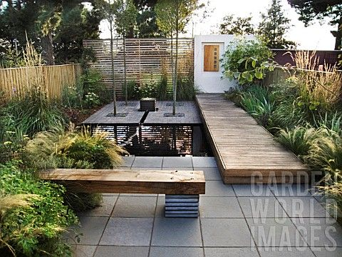 Contemporary urban garden with sleepers rhs wisley surrey for Modern zen house design with roof deck