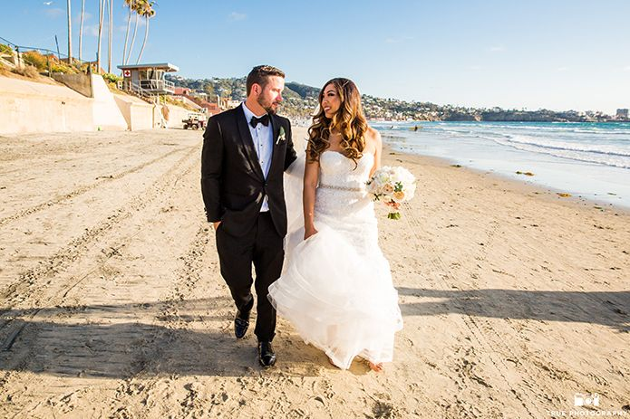 San Diego Beach Wedding At The Scripps Seaside Forum Bride Mermaid Style Gown With Crystal Belt Holding White Floral Bridal Bouquet Groom Black Tuxedo