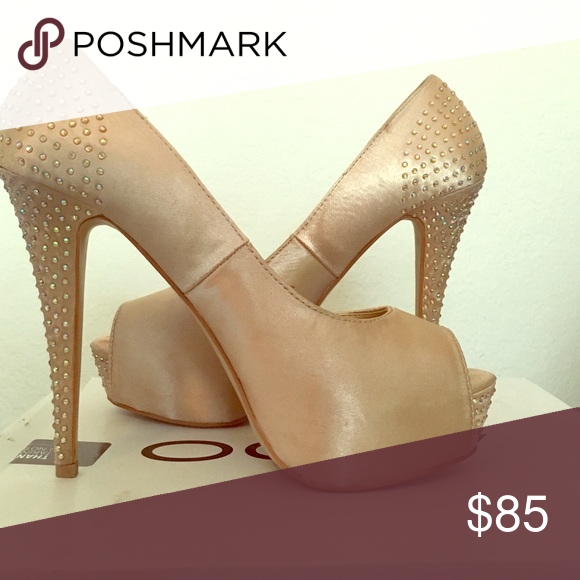 Aldo heels Only worn once! Super comfortable heels. Champagne color with studs along the back and heel. Aldo Shoes Heels