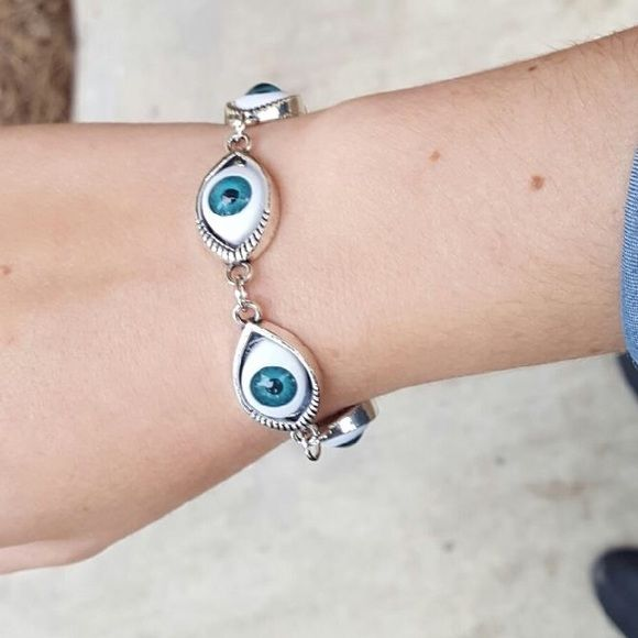 """Brand new, never worn """"I see you"""" bracelet 5 gorgeous eyes surrounded with silver encircle your wrist.  The eyes are not painted on but created to show depth in the irises.  The milky color is a reflection of the light, not a flaw. I love this piece! Jewelry Bracelets"""