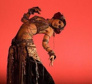 I miss belly dancing..... I was this >-----< close to that very back bend.  Damn you, stage fright.