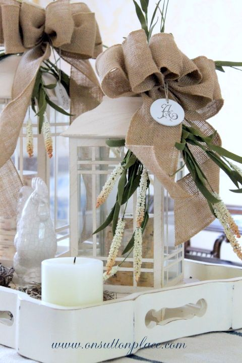 Cute burlap bows on lanterns, could use Christmas flowers.  (link goes to blog but not to direct post)