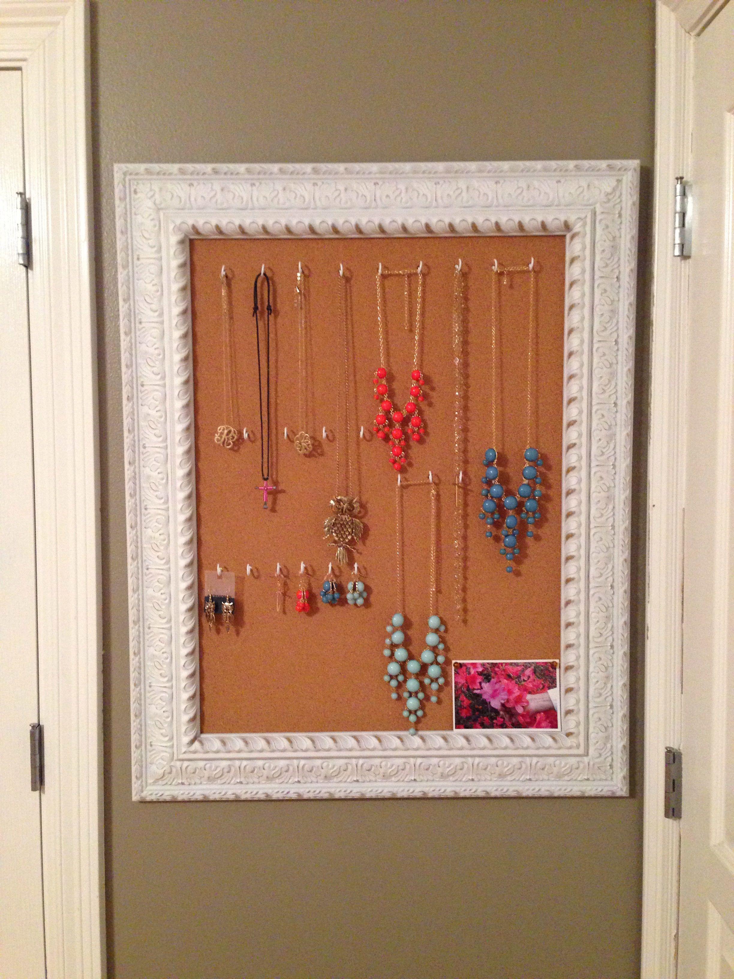 Framed corkboard from Hobby Lobby & little hooks from Lowe s kes