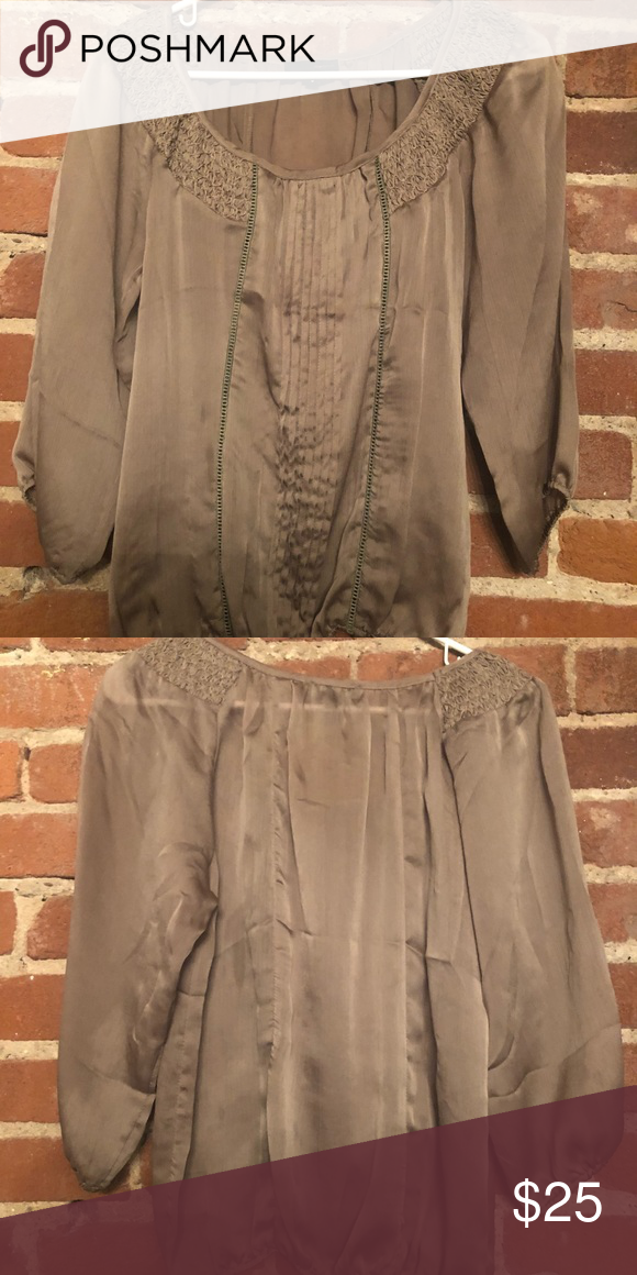 453f2a37232 Lovposh Taupe Blouse Cute work top with gathered sleeves and pleating on  the front. Only