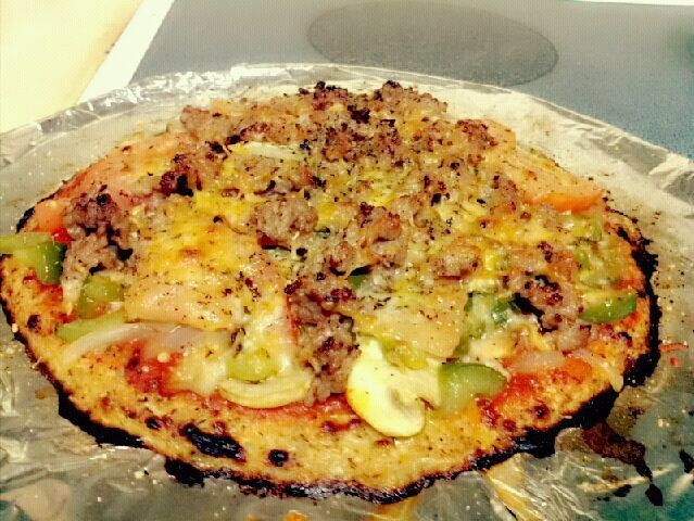 Cauliflower Crust Pizza!   I loaded up on veggies (onions, tomatoes, bell peppers, and mushrooms). I also used some breakfast sausage for protein! Of course I cannot forget a light sprinkle of cheese and olive oil. Overall this was easy to make. However the crust was not as firm as I hoped it would have turned out. It seems like other people had this soft crust issue too. The taste will still super awesome though....YUUUUUUUM!!!!