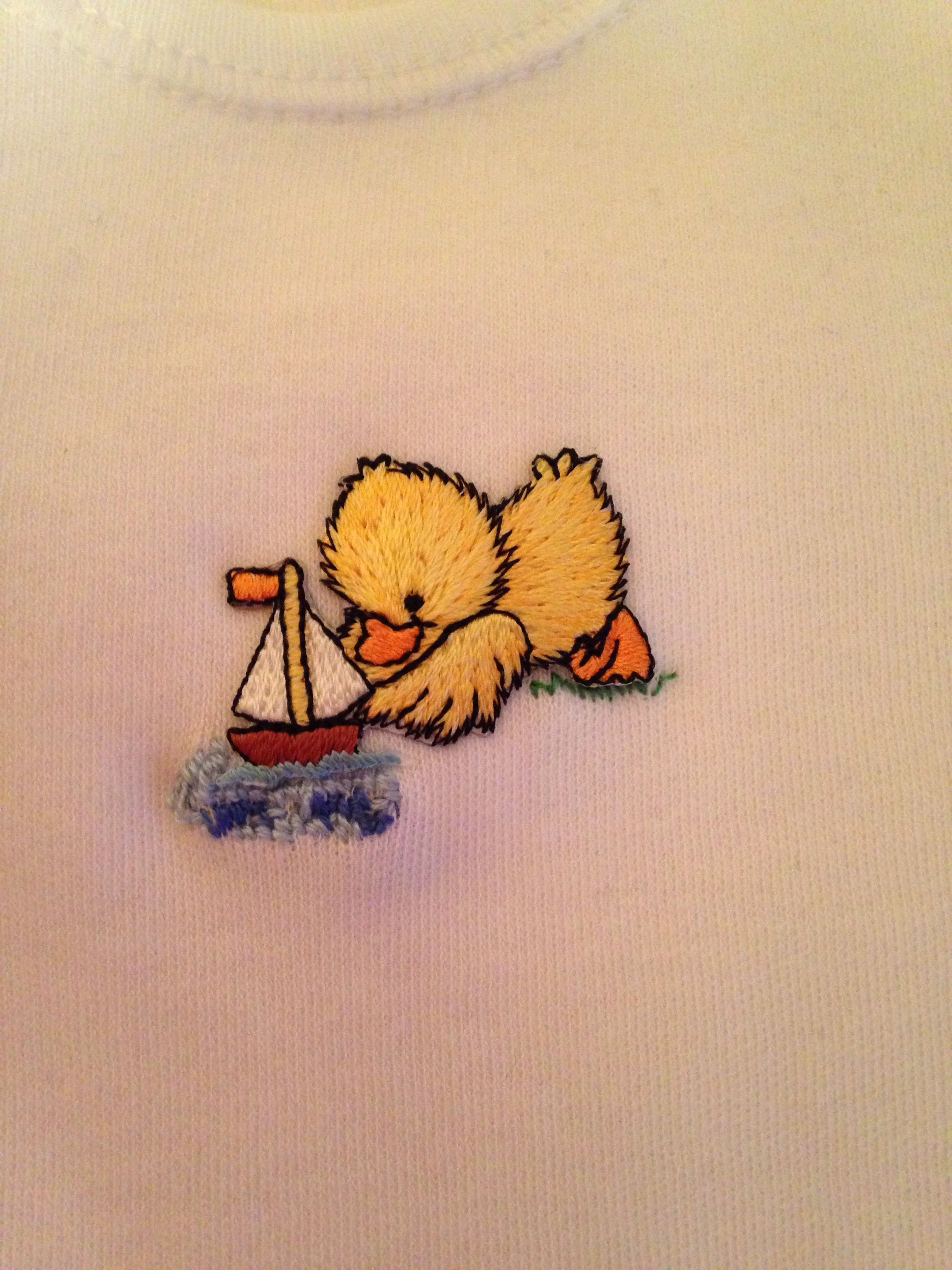 Ducky with sail boat appliqué on long sleeve baby grow